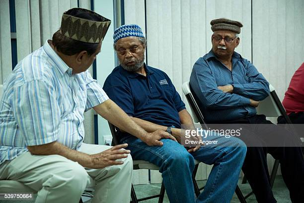 Worshippers talk with each other before praying during a prayer service at the BaitulAafiyatr Mosque June 12 2016 in Orlando Florida The shooting at...