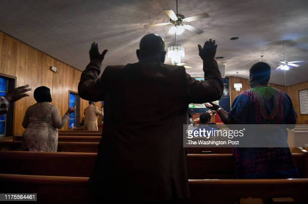 Worshippers took part in a revival led by Pastor Michael Ruffin at the Greater First Missionary Baptist Church in Lisman, Alabama on July 2019. The...