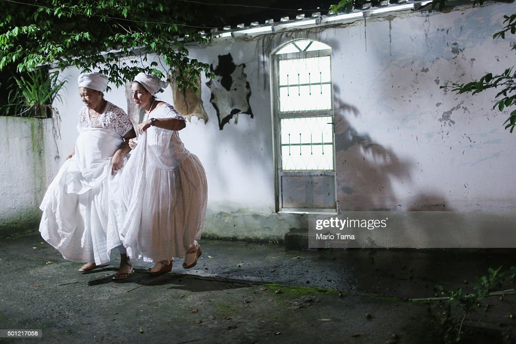 Worshippers walk during a Candomble ceremony honoring goddesses Iemanja and Oxum on December 13, 2015 in Itaborai, Brazil. Candomble is an Afro-Brazilian religion whose practitioners sometimes fall into trances during ceremonies believing they have become possessed by gods, or orixas. The roots of the Candomble religion came to Brazil via African slaves and eventually incorporated some elements of Catholicism. Afro-Brazilian religions generally refer to Iemanja as goddess of the sea and Oxum as goddess of rivers, lakes and waterfalls, or fresh water.
