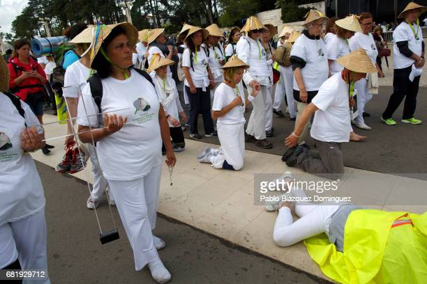 Worshippers walk on their knees and lay on the ground in the Sanctuary of Fatima on May 11 2017 in Fatima Portugal Pope Francis will be attending the...