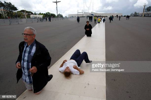 Worshippers walk on their knees or crawl in the Sanctuary of Fatima on May 11 2017 in Fatima Portugal Pope Francis will be attending the Sanctuary of...
