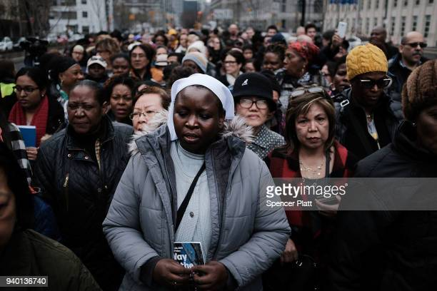 Worshippers walk to a station during the Way of the Cross procession over the Brooklyn Bridge on March 30 2018 in New York City The Way of the Cross...