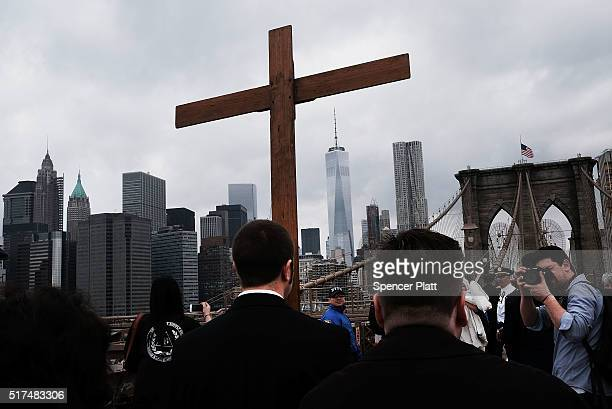 Worshippers walk to the station during the Way of the Cross procession over the Brooklyn Bridge on March 25 2016 in New York City The Way of the...