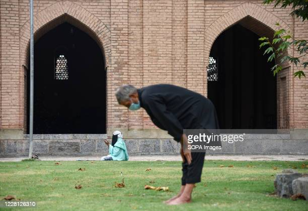 Worshippers wearing face mask offer prayers at Jamia masjid. Authorities in Indian administered Kashmir re-opened religious places after nearly 5...