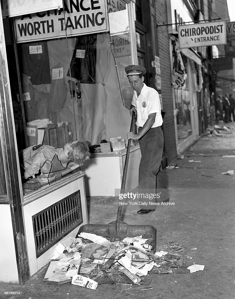 'Worth Taking,' reads this now ironic sign over this wrecked store on August 2, 1943 in Harlem, New York. That's a dummy jutting out window.