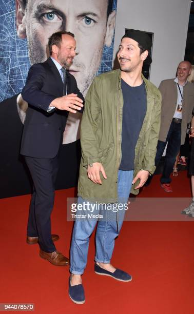 Wotan Wilke Moehring and Fahri Yardim attend the 'Steig Nicht Aus' Premiere on April 9 2018 in Berlin Germany