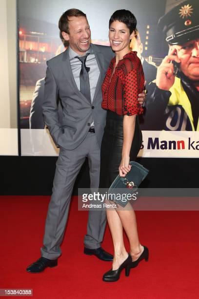 Wotan Wilke Moehring and Jasmin Gerat attend the 'Mann Tut Was Mann Kann' Germany Premiere at CineStar on October 9 2012 in Berlin Germany