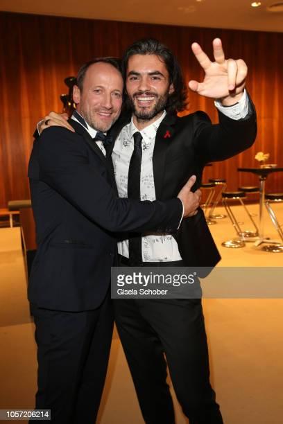Wotan Wilke Moehring and Nik Xhelilaj Winnetou during the 25th Opera Gala at Deutsche Oper Berlin on November 4 2018 in Berlin Germany
