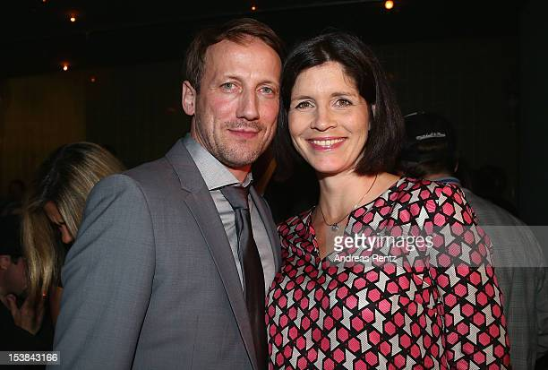 Wotan Wilke Moehring and partner Anna Theis attend the 'Mann Tut Was Mann Kann' Germany Premiere after show party on October 9, 2012 in Berlin,...