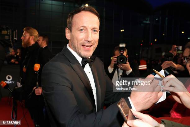 Wotan Wilke Moehring signs autographs as he arrives for the Goldene Kamera on March 4 2017 in Hamburg Germany