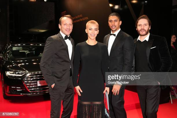 Wotan WilkeMoehring Alina Sueggeler singer of the band 'Frida Gold' Andreas Bourani and Daniel Bruehl during the 24th Opera Gala benefit to Deutsche...