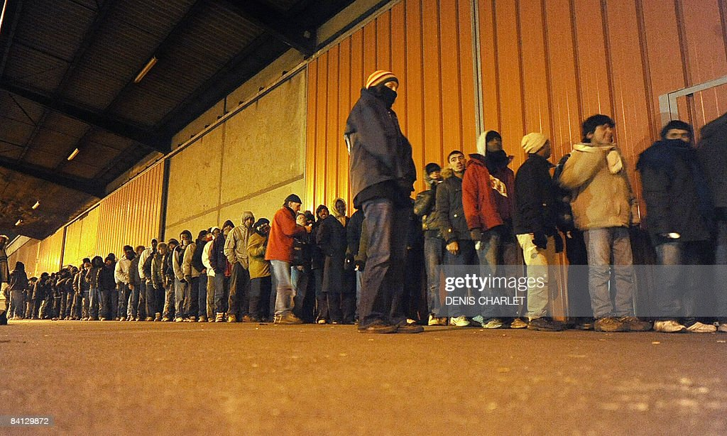 Would be illegal immigrants queue to hav : News Photo