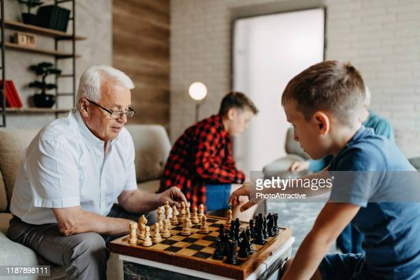 i would like you to learn me how to play - game night leisure activity stock pictures, royalty-free photos & images