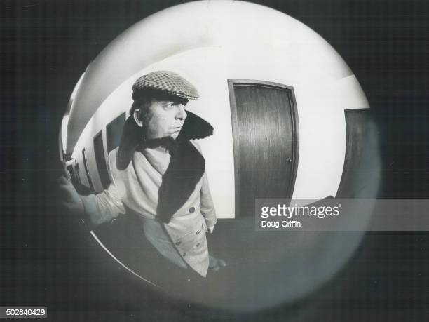 Would you open the door of your apartment to a man who looked like this The optical distrortion of the fish eye lens used in a wide angle door viewer...