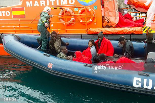 Wouldbe immigrants are pictured on a Spanish Guardia civil motorboat in Tarifa southern Spain on October 30 2012 after being rescued from a rickety...