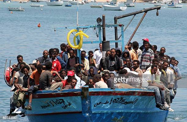 Wouldbe immigrants arrive on a boat in the port of Italy's southern island of Lampedusa late on July 31 2008 Italy's coast guard intercepted around...