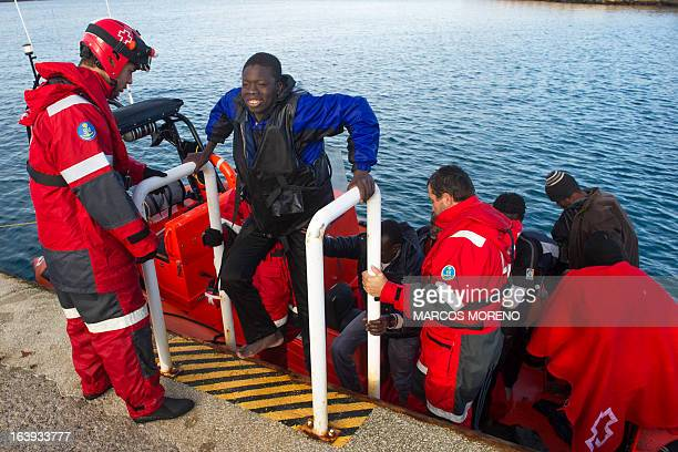 Wouldbe immigrants disembark a boat of the Red Cross at Tarifa's harbour on March 18 after being rescued off the Spanish coast Spanish rescuers...