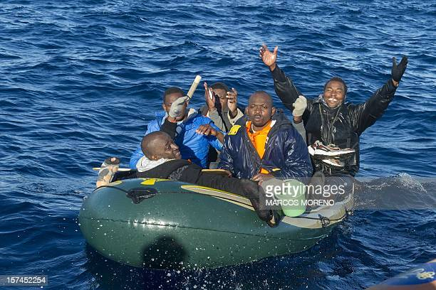 Wouldbe immigrants react after being rescued by Spanish emergency services in the Strait of Gibraltar on December 3 2012 Spanish emergency services...