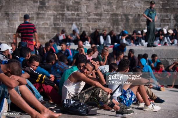 Wouldbe immigrants rest after being rescued in the waters of the Strait of Gibraltar in the port of Tarifa on August 16 2017 Since 1am today the...