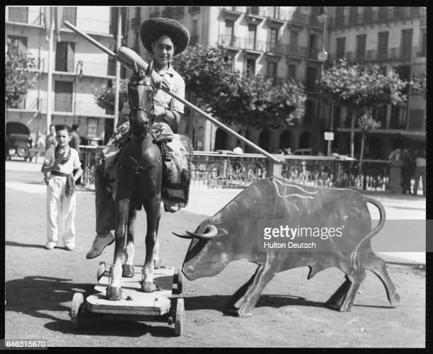 A wouldbe picador practices his art in the main square in Pamplona during the fiesta season