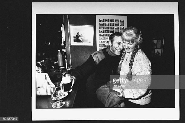 Wouldbe screenwriter Douglas Gresham son of Amer poet Joy Gresham executor of his stepdad CS Lewis's estate affectionately nuzzling his wife Meridith...