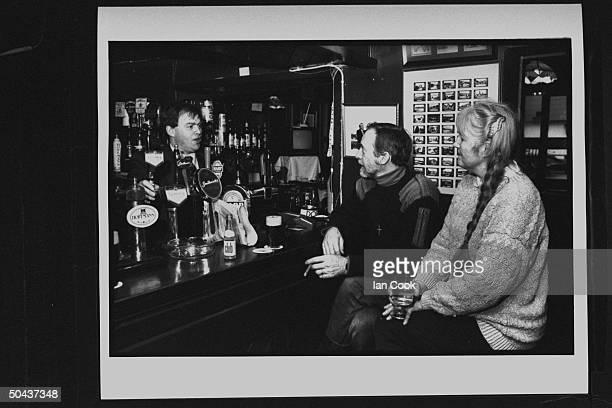 Wouldbe screenwriter Douglas Gresham son of Amer poet Joy Gresham executor of his stepdad CS Lewis's estate chatting w bartender as he sits w his...