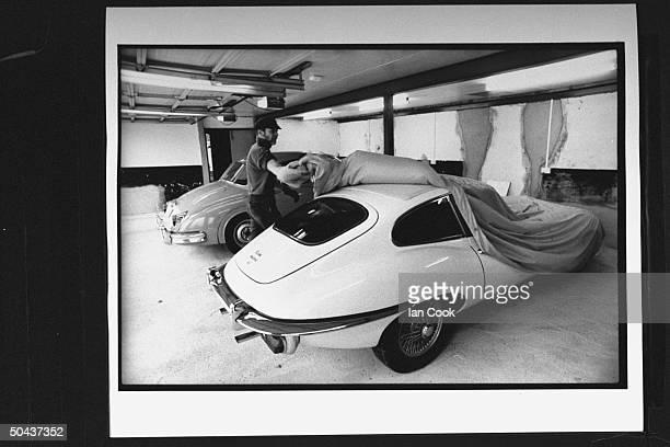 Wouldbe screenwriter Douglas Gresham son of Amer poet Joy Gresham executor of his stepdad CS Lewis's estate taking cover off of one of his vintage...