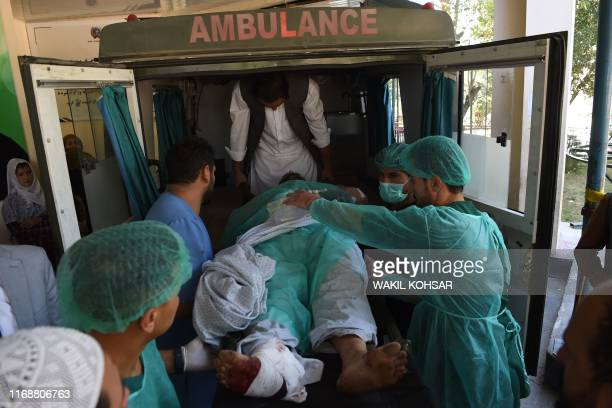A wounded Afghan man is transported in an ambulance at the Wazir Akbar Khan hospital following a blast in Kabul on September 17 2019 A suicide bomber...