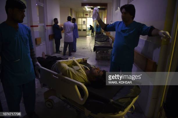 A wounded Afghan man receives treatments at the Wazir Akbar Khan hospital after a car bomb attack in Kabul on December 24 2018 Militants detonated a...