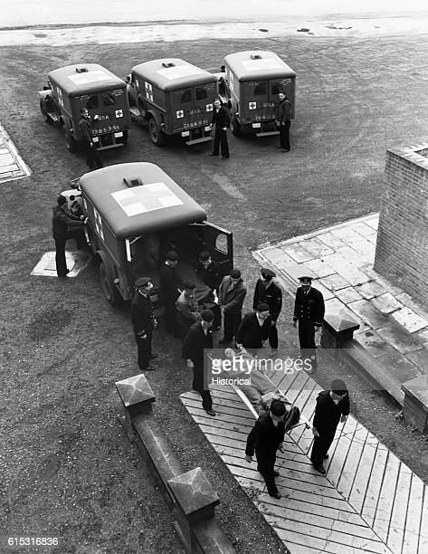 'Wounded' are carried from ambulances into a Navy hospital as part of a training drill for DDay England June 1 1944