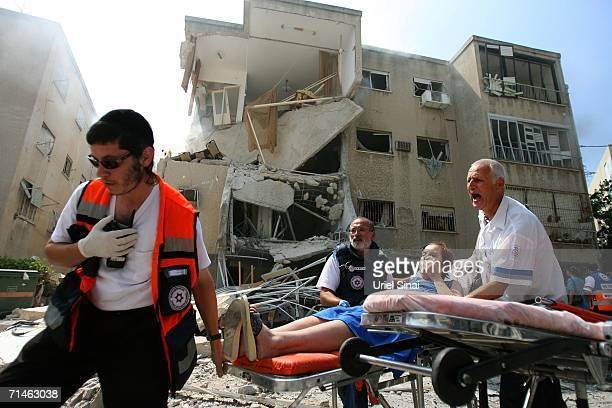 Wounded are taken away after a Hezbollah missile strike July 17, 2006 in the northern Israeli city of Haifa. At least 12 Israeli civilians have been...