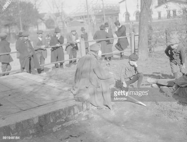 Wounded Austrian soldier talking to little boys at Lemberg. September 1914