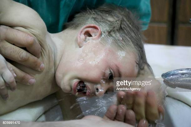 A wounded baby receives treatment at a Sahra hospital after Assad Regime's forces attacked with missiles over the deconflict zone Ayn Tarma town in...