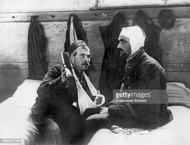 A wounded Belgian soldier takes his first look into a mirror after his recovery from a severe head wound during WWI Antwerp Belgium circa 1916