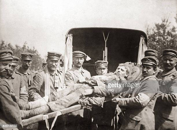 A wounded British prisoner of war is stretchered to an ambulance by German troops circa 1916