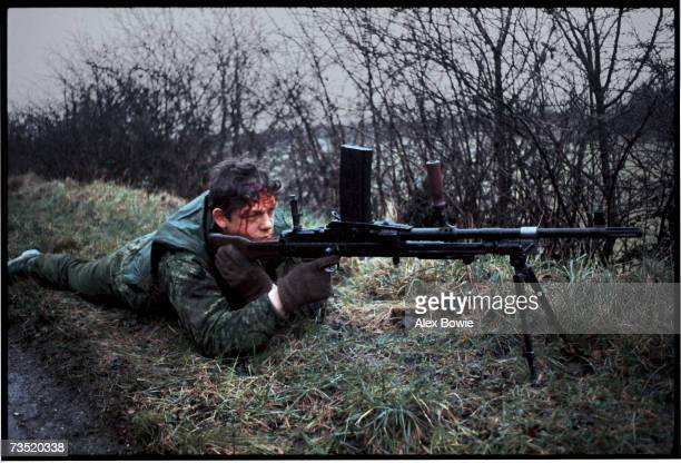 A wounded British soldier manning a machine gun while on patrol in County Fermanagh along the border of Northern Ireland and the Republic of Ireland...
