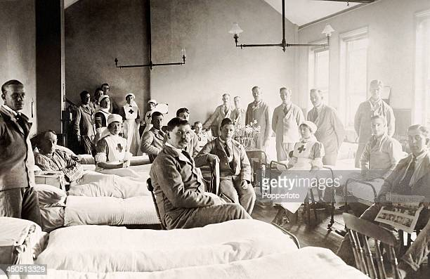 Wounded British soldiers and their nurses in a hospital ward circa 1916