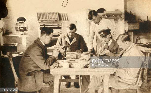 Wounded British soldiers in pottery class Seale Hague Military Hospital Devon First World War 19141918 'soldiers found time hanging dreadfully heavy...