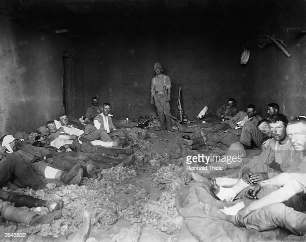 Wounded British soldiers photographed in a filthy wagon house at Klip Drift on the Modder River during the Boer War This kind of image contrasted...