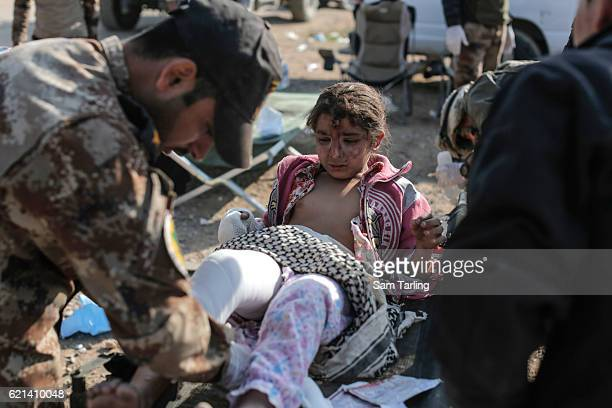 Wounded child is given medical assistance by Iraqi Special Forces in the Zahara neighbourhood on the north eastern edge of Mosul as fighting...