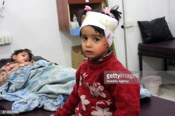 Wounded children receive treatment at a sahra hospital after Assad regime's warcrafts carried out an airstrike over residential areas of Arbin town...
