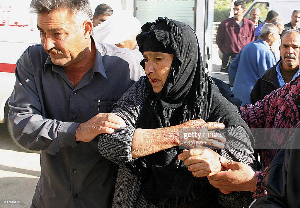 A wounded elderly Iraqi woman is evacuat : News Photo
