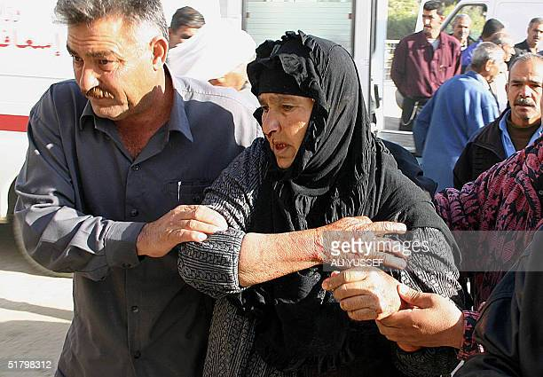 A wounded elderly Iraqi woman is evacuated into hospital in the restive city of Baquba 60 kms northeast of Baghdad 28 November 2004 The woman along...