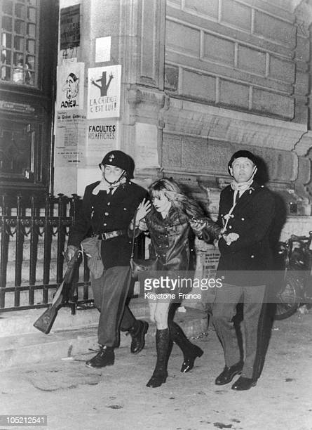Wounded Female Demonstrator Arrested By Two Police Officers Before The Sorbonne On Rue Des Ecoles On May 24 1968