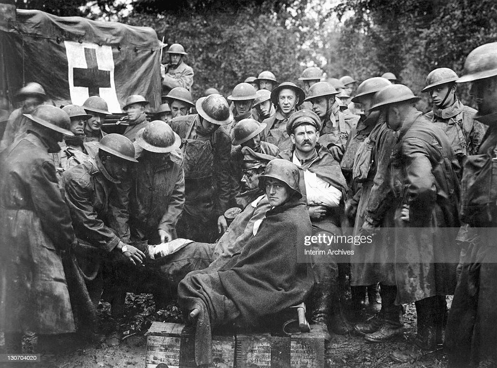 German Prisoners Receive First Aid : News Photo