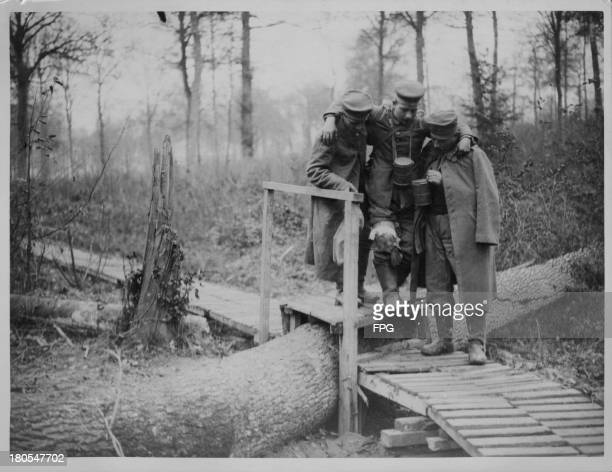 Wounded German soldiers walking to safety following a battle on the Cambrai front France circa 19141918
