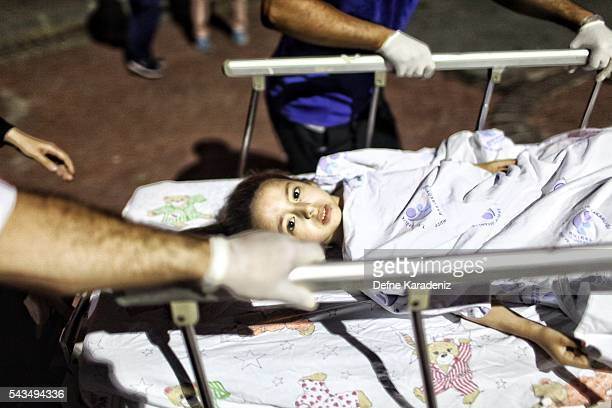 A wounded girl from the Ataturk Airport suicide bomb attack is carried to the Bakirkoy Sadi Konuk Hospital in the early hours of June 29 2016 in...