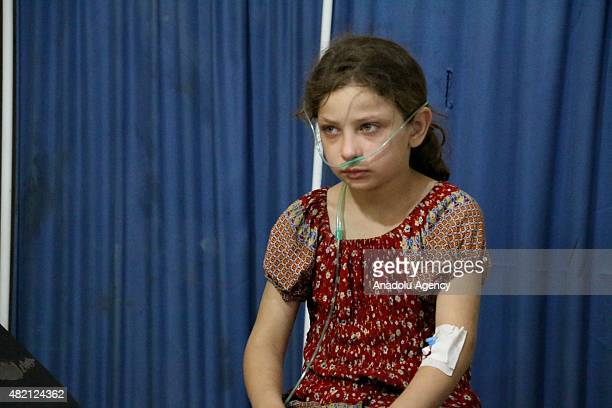 A wounded girl who affected allegedly Assad forces chlorine war gas attacks is treated at hospital in Ayn Tema district of Damascus Syria on July 27...