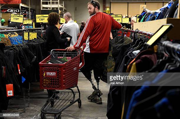 Wounded in 2003 in Iraq combat vet Mike Cain looking for snow pants at Sports Authority as he gears up for the No Boundaries program hosted by the...