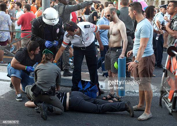 A wounded Israeli receives treatment during the Gay Pride Parade on July 30 2015 in Jerusalem Israel At least six people were stabbed at Jerusalem's...